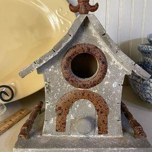 Decorative birdhouse with fleur de Lis on top